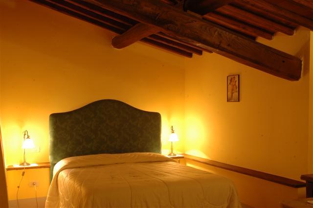 Hotel la costa antica fattoria siena camere for Piani di fattoria con veranda